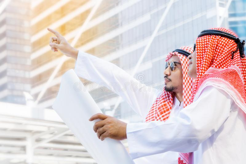 Arab business people in a meeting, business people. Standing in the construction site discussing work stock photos