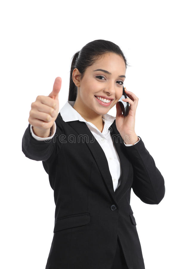 Arab business woman calling on the phone and thumb up. Isolated on a white background stock photos