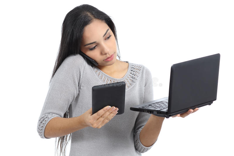 Arab business woman multi tasking busy with phone tablet and computer royalty free stock photos