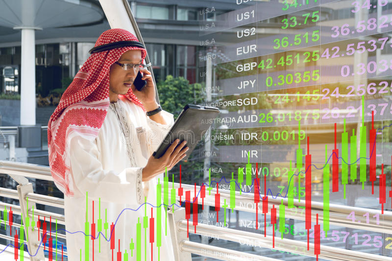 Arab businessman check graph on smartphone. Finance concept stock photography