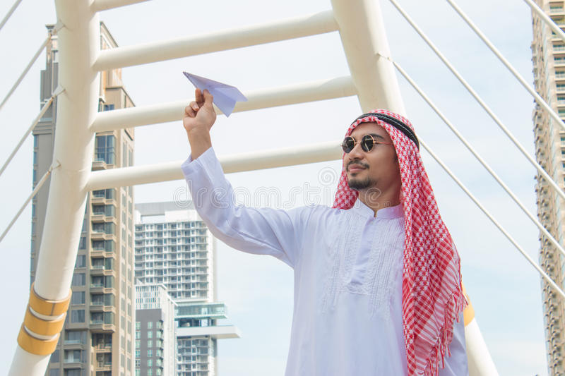 Arab businessman with paper airplane. royalty free stock photo