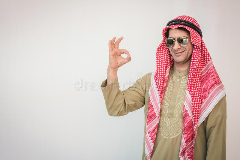 Arab businessman pointing up ok hand sign stock photography