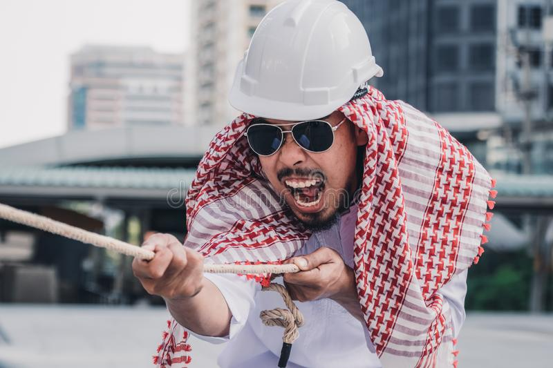 Arab businessman Pull the rope stock photo
