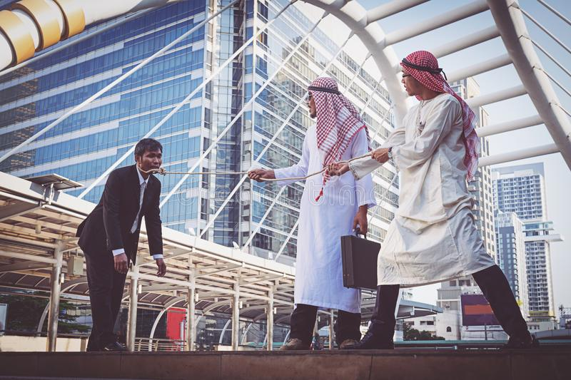 Arab businessman Pull the rope royalty free stock image