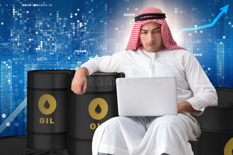 The arab businessman trading crude oil on laptop. Arab businessman trading crude oil on laptop stock images
