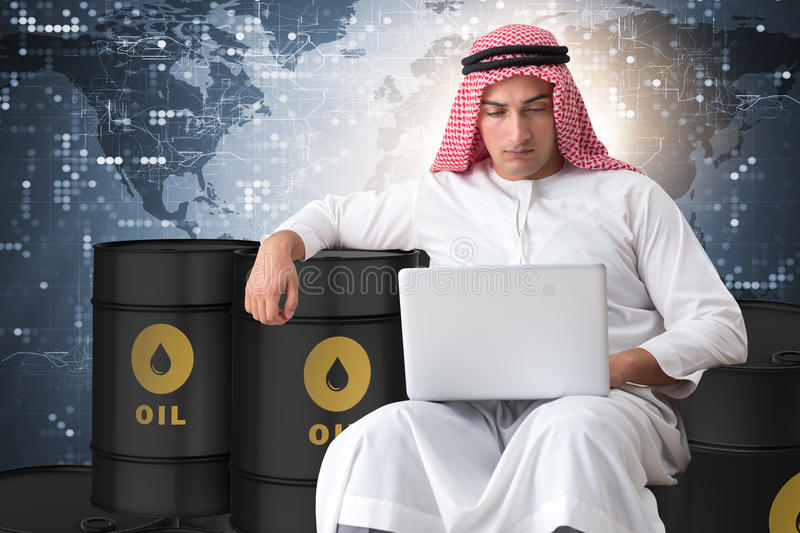 The arab businessman trading crude oil on laptop. Arab businessman trading crude oil on laptop stock photography