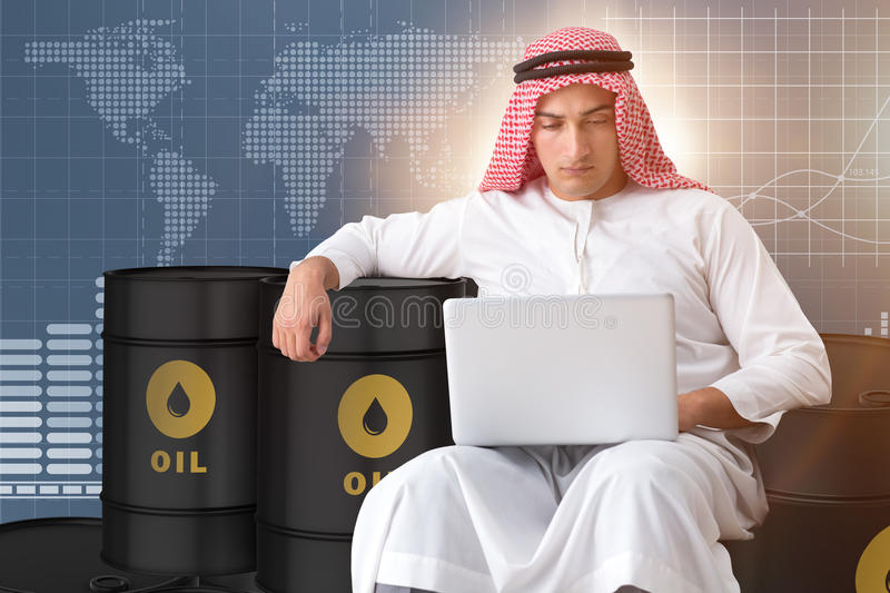 The arab businessman trading crude oil on laptop. Arab businessman trading crude oil on laptop stock image