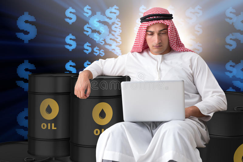 The arab businessman trading crude oil on laptop. Arab businessman trading crude oil on laptop royalty free stock photo