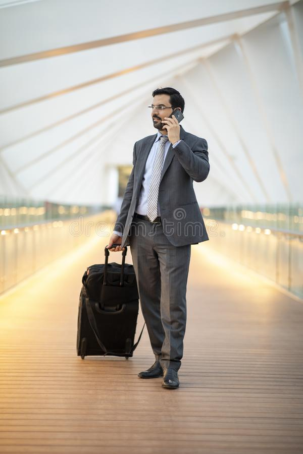Free Arab Businessman With His Suitcase Looking At The City View Of Dubai Royalty Free Stock Images - 131954929