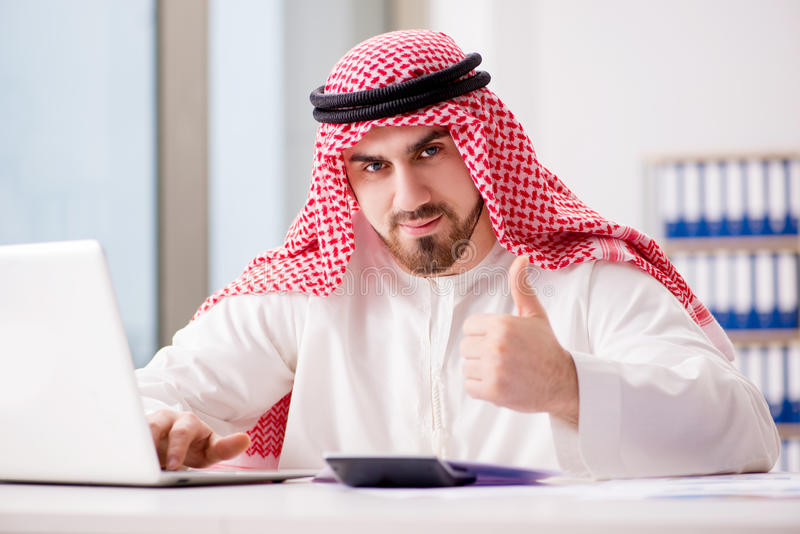 The arab businessman working on laptop computer stock images
