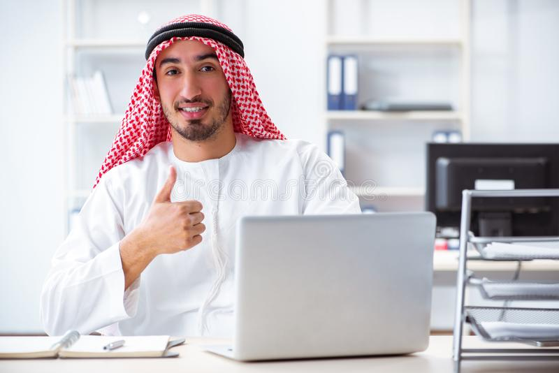 The arab businessman working in the office royalty free stock photography