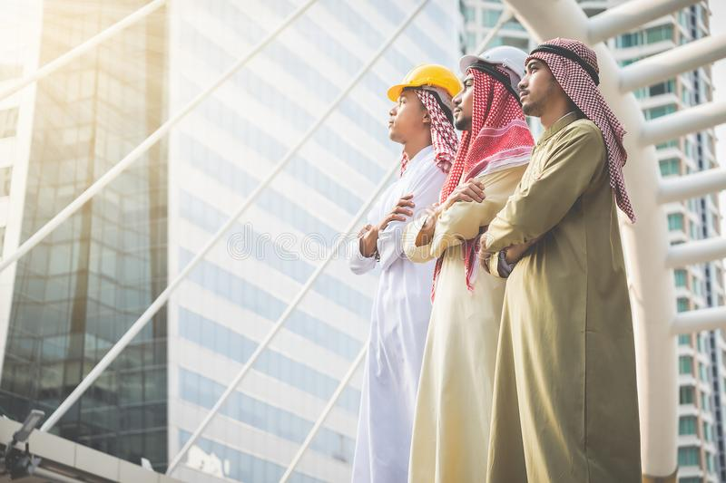 Arab businessmen and architects stand confident in their success stock image