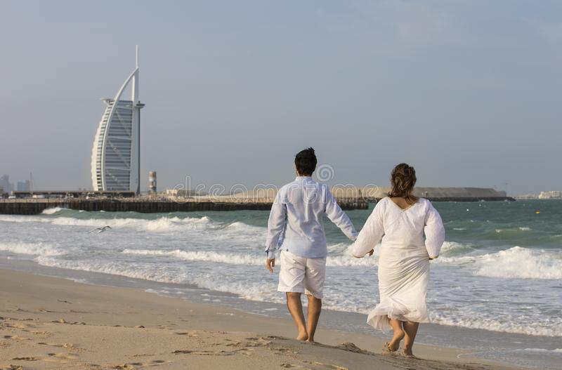 Arab couple walking on the beach stock images