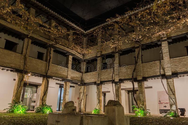 An Arab courtyard at night. An Arab courtyard with a fountain at night in Granada royalty free stock photography