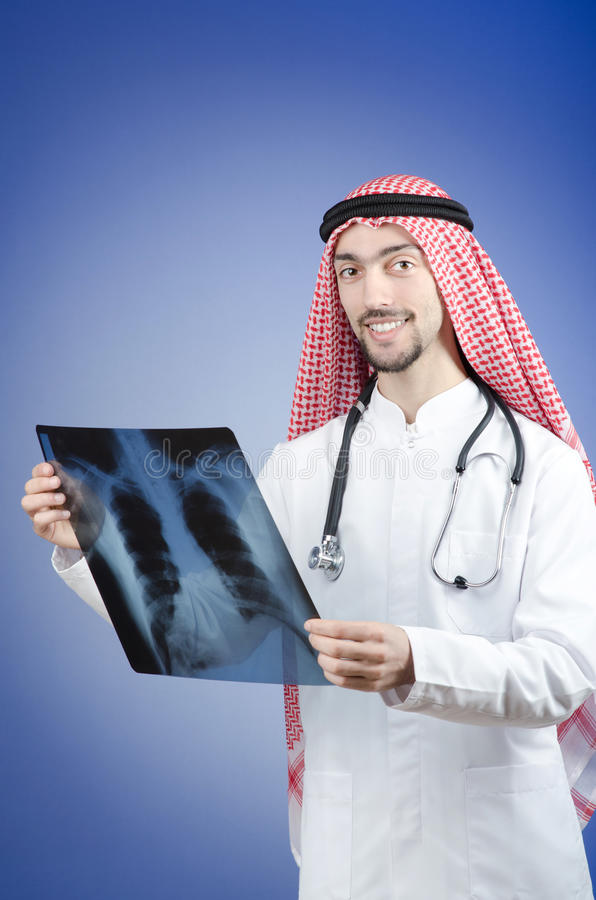 Arab doctor with x-ray stock images