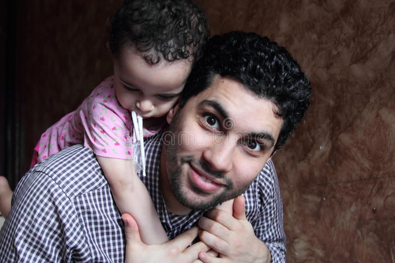 Arab egyptian man or father lifting his baby girl royalty free stock photo