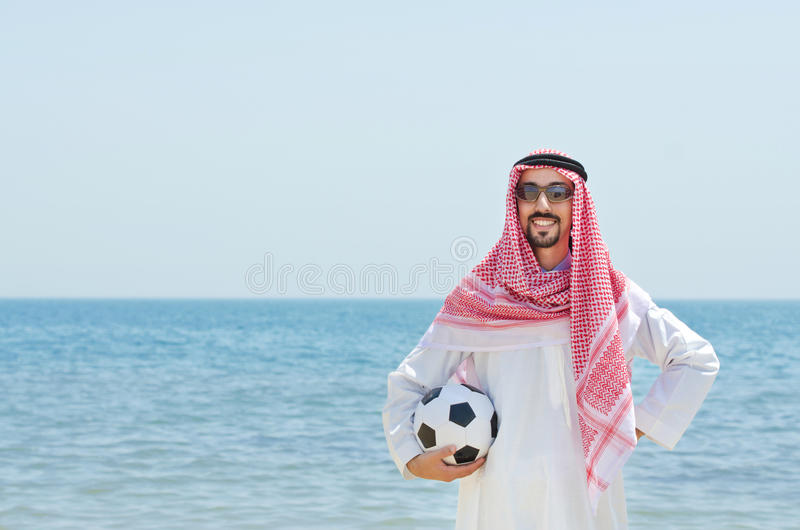 Arab with footbal at seaside royalty free stock photos