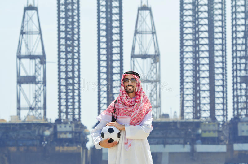 Arab with footbal at seaside stock images