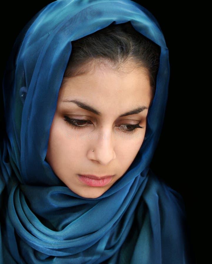 Arab girl in blue scarf stock photo