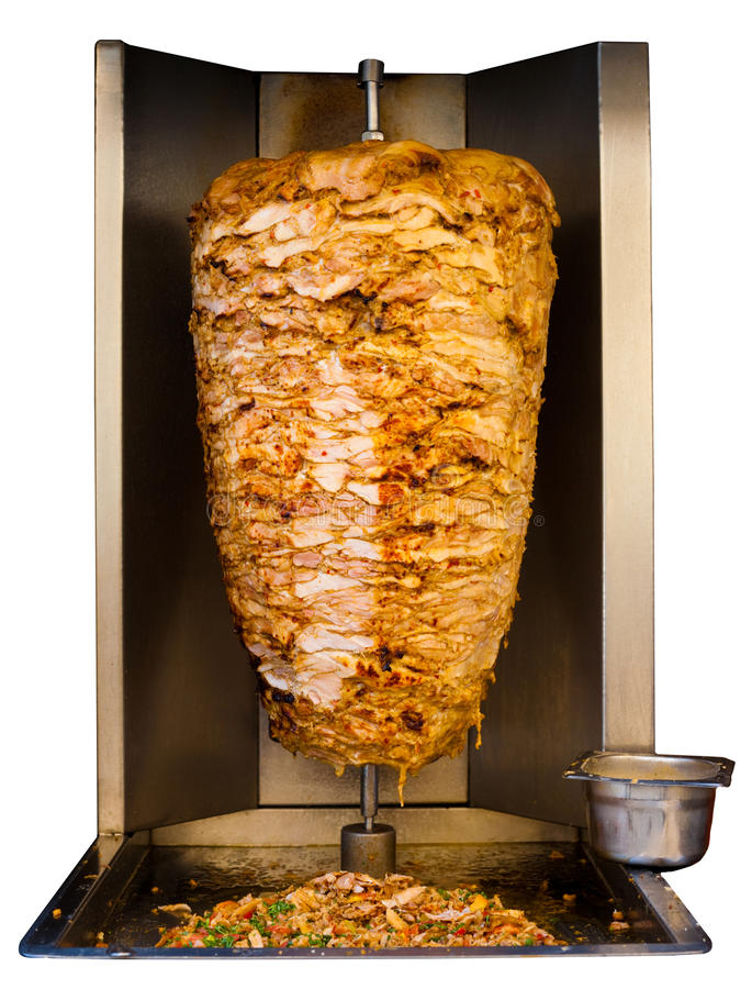 Arab Grilled Chicken Shawarma Meat Cooking White. Grilled skewered chicken, a traditional meat served inside a shawarma sandwich in the Arab countries in Middle stock image
