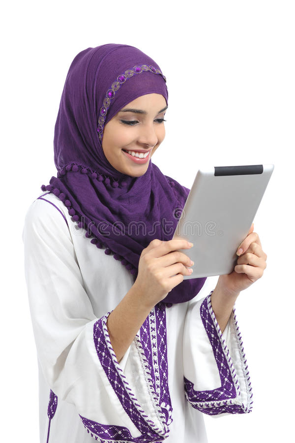Arab happy woman reading a tablet reader. Isolated on a white background stock photography