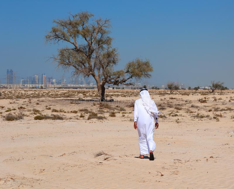 Arab man in desert stock photography