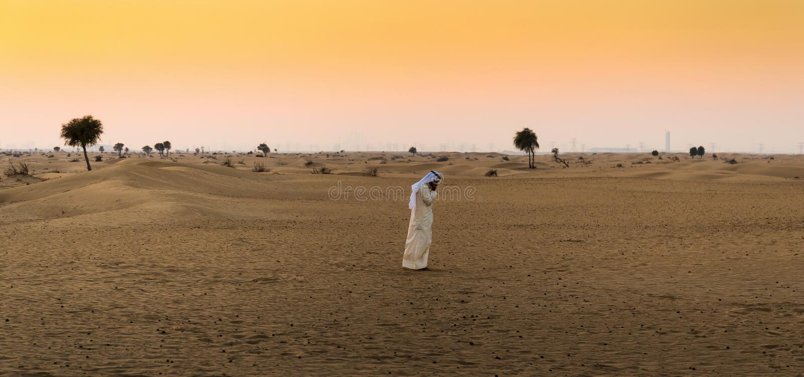 Arab man in the desert stock photo