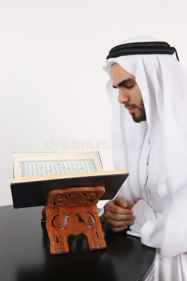 Arab Man Reading The Quran Stock Photos