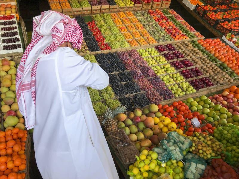 Arab man sells fresh fruits. stock photos