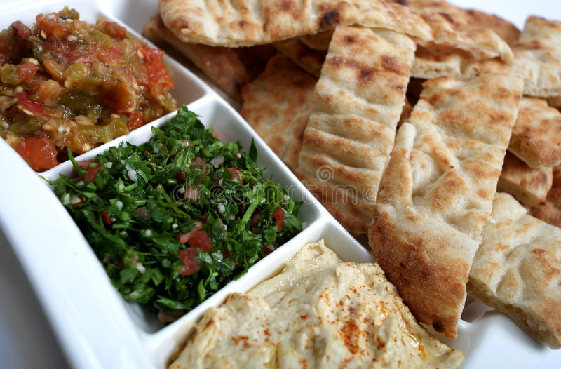 Arab mezzes and bread royalty free stock image