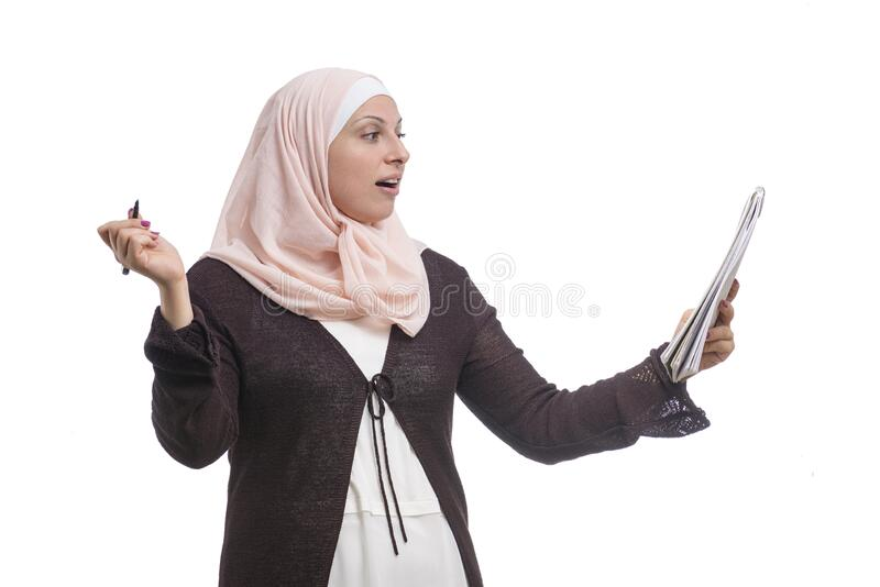 Arab Muslim businesswoman found a solution dressed in traditional Islamic clothing stock image