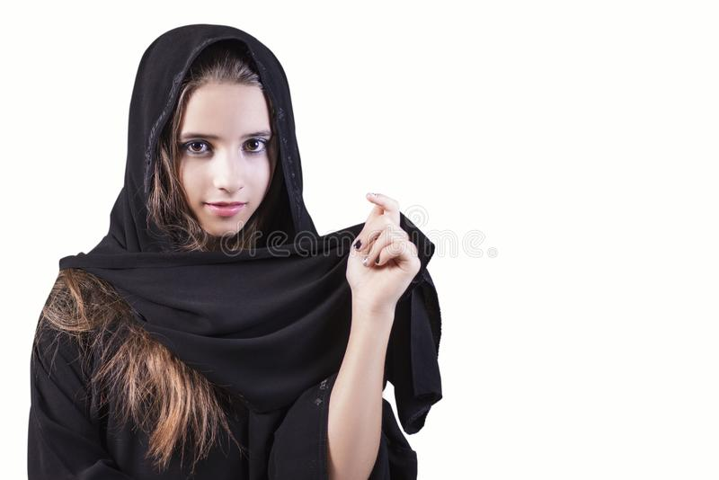 Arab ,muslim,girl closeup on a white background.Arab saudi emirates woman face looking at side isolated on a white background royalty free stock image