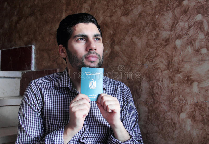 Arab muslim man with egypt passport royalty free stock images