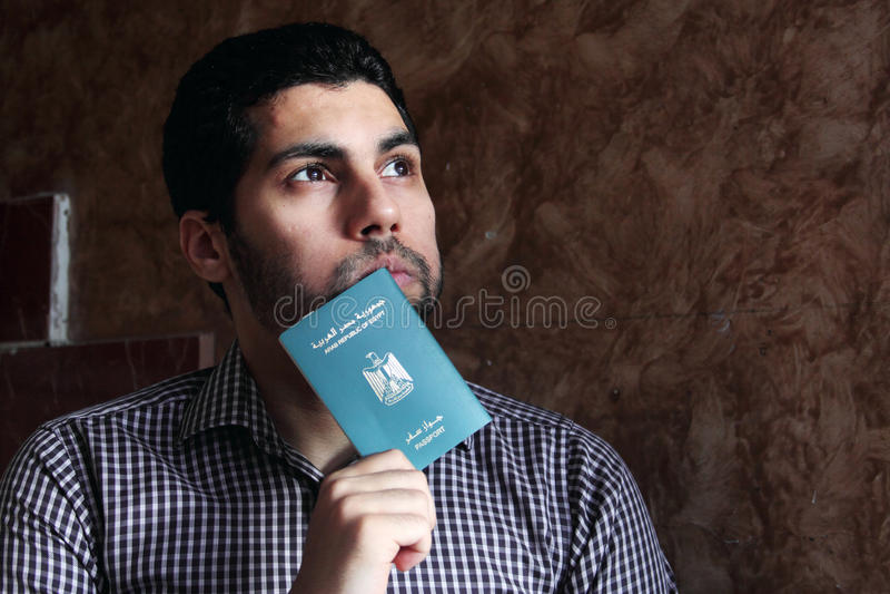 Arab muslim man with egypt passport stock image