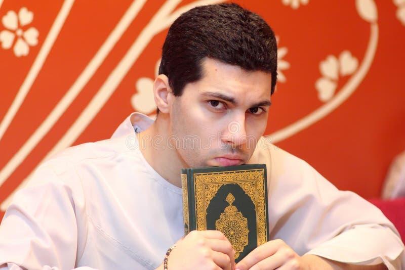 Arab muslim man with koran holy book stock photography