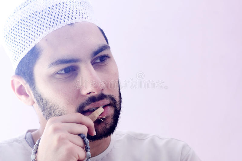 Arab muslim man with toothbrush miswak stock images