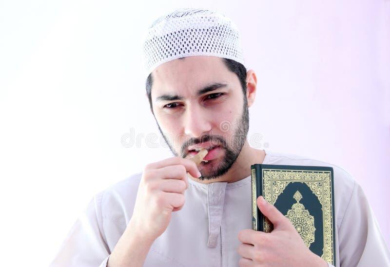 Arab muslim man with toothbrush miswak stock photo