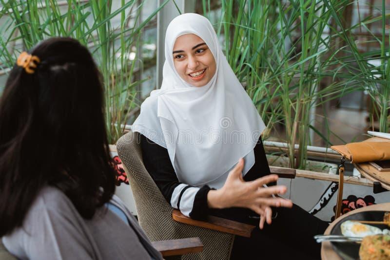Arab muslim woman in conversation stock photography