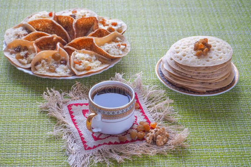 Arab pancakes with herbal tea sage. Sweet food in Ramadan. royalty free stock photos