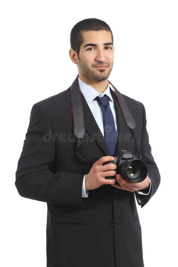 Arab professional photographer holding a dslr digital camera. Isolated on a white background royalty free stock images