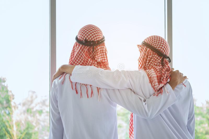Arab saudi businessman with friend in hotel royalty free stock images