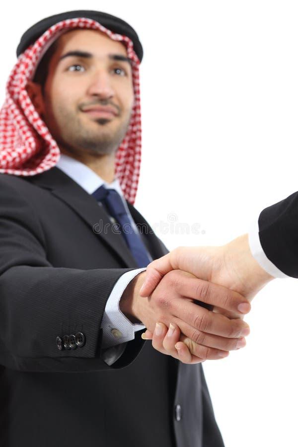 Arab saudi emirates business man handshaking. Arab saudi emirates business men handshaking isolated on a white background royalty free stock image