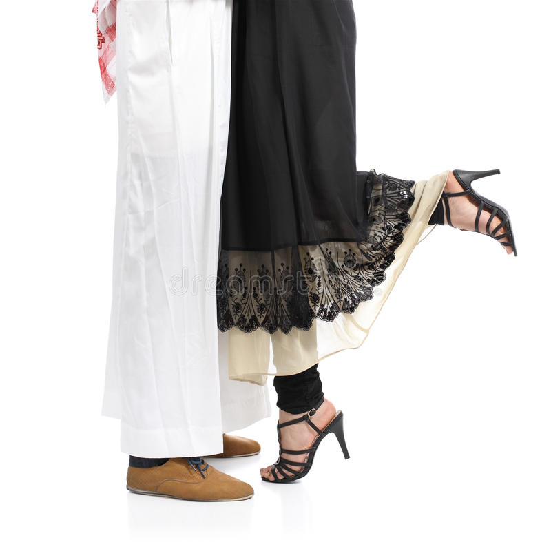Arab saudi emirates couple legs hugging stock images