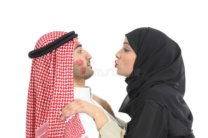 Arab saudi obsessed woman kissing a man stock photography