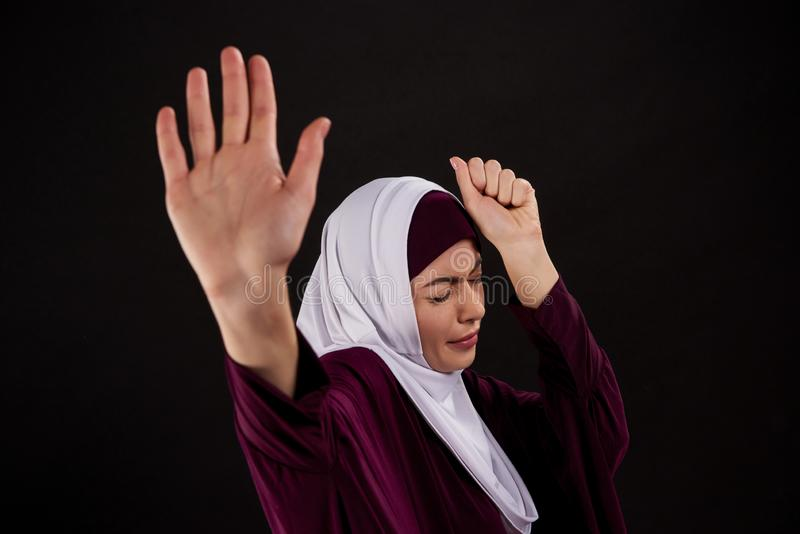 Arab scared woman in hijab defends herself royalty free stock images