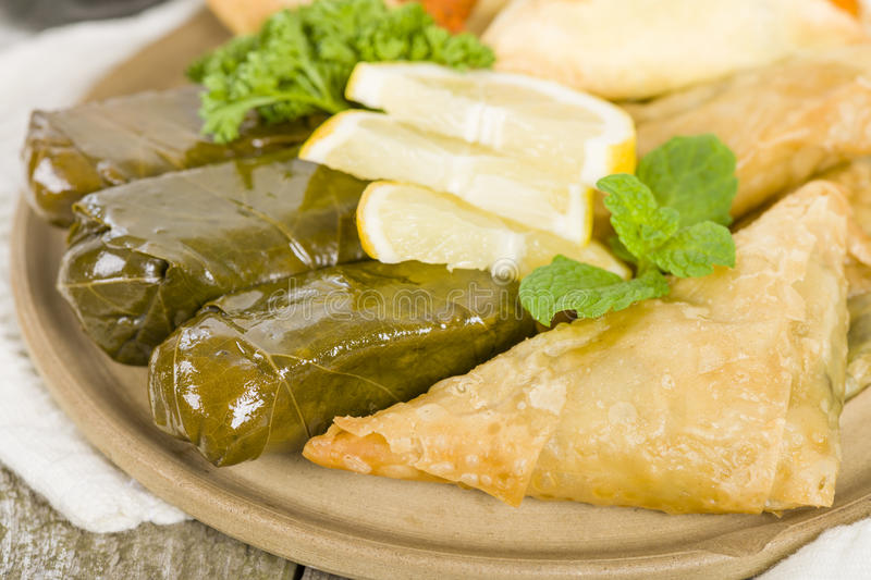 Arab Snacks. Sarma (grape vine leaves, stuffed with rice), borek (spinach and cheese stuffed pastry) and fatayer (meat pie royalty free stock photography
