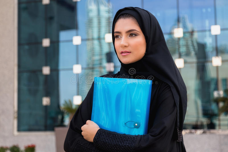 Arab Student. Holding a folder royalty free stock photography