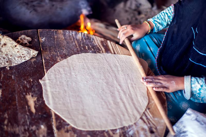 Arab woman makes bread in the beduin village in Egypt royalty free stock images