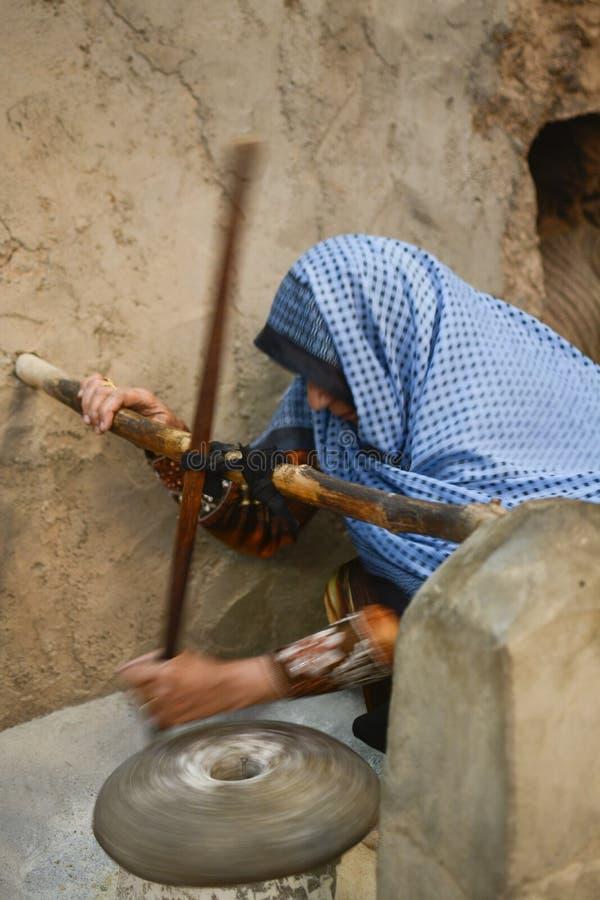 Arab woman grinding royalty free stock photo