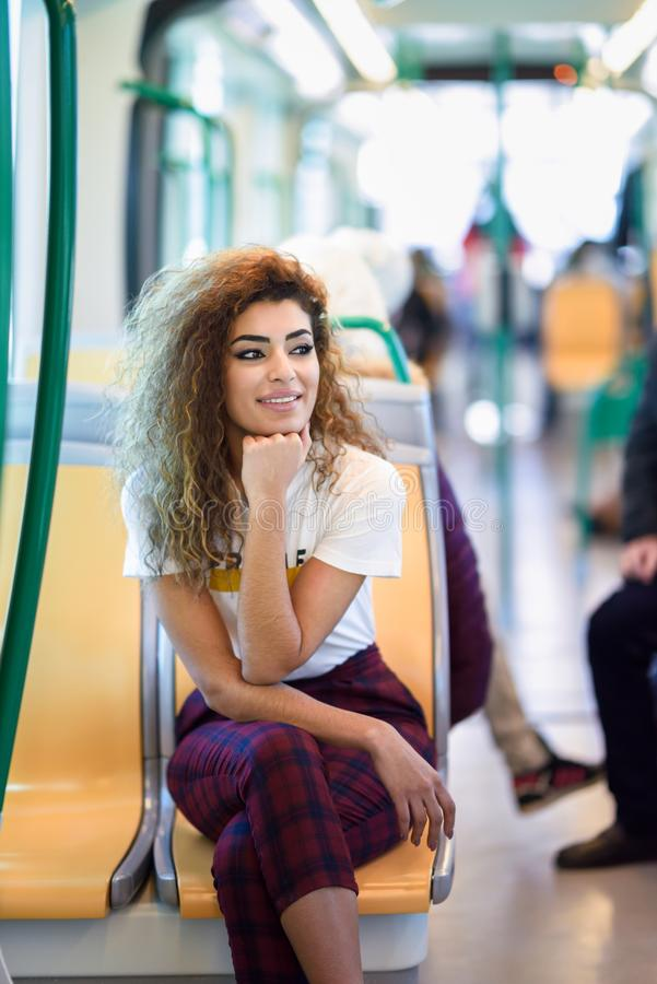 Arab woman inside metro train. Arab girl in casual clothes. royalty free stock photography